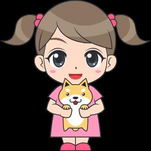 犬を抱っこする女の子(子供)