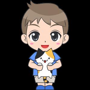 猫を抱っこする男の子(子供)